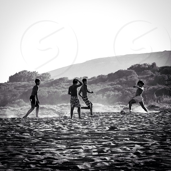 Kids playing beach soccer photo