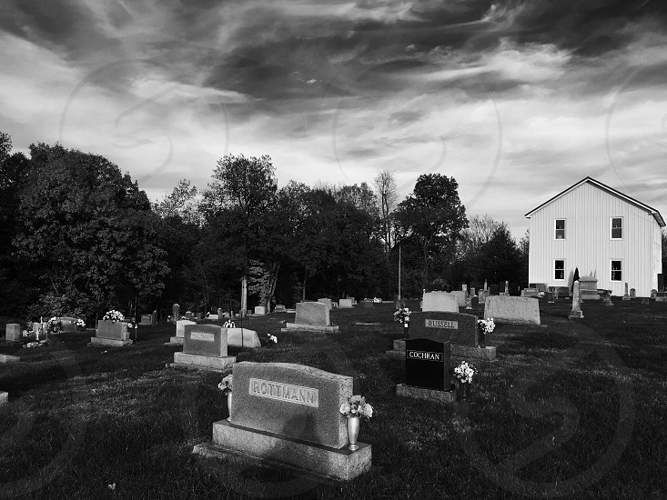 A little church n cemetery. Took it in black and white. The church is really old photo