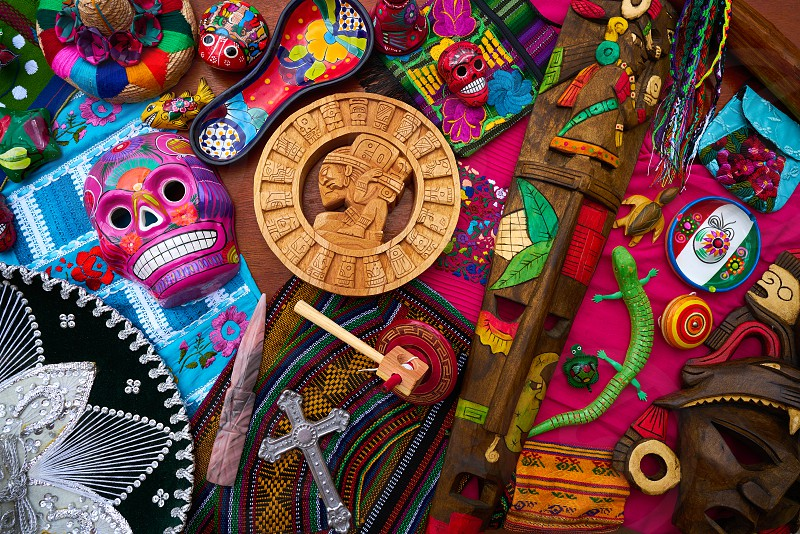 Mayan mexican handcrafts souvenirs carved skulls embroidery photo