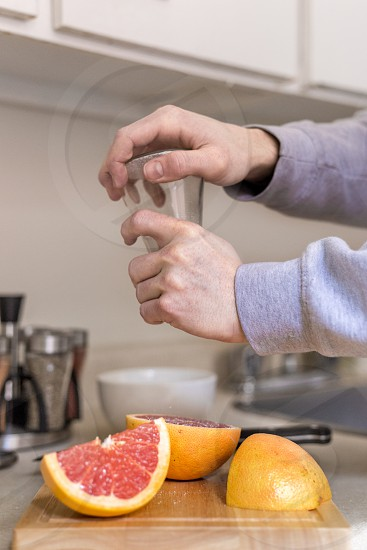 Job and food editorial - chef cutting fruits. photo