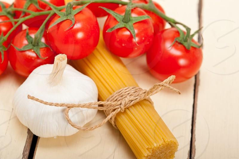 Italian basic pasta fresh ingredients cherry tomatoes garlic photo