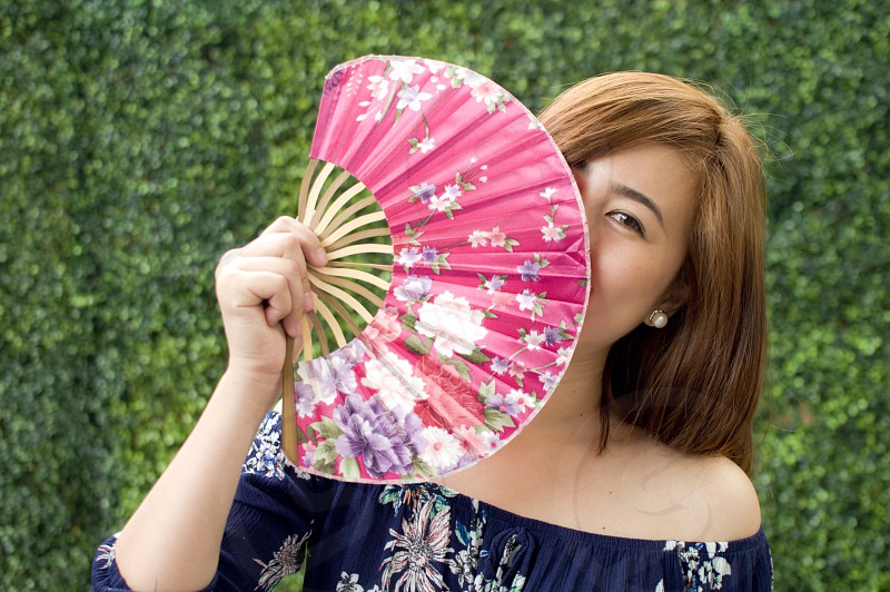 A portrait of a woman holding a traditional fan photo