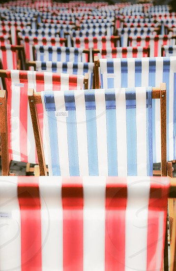 Stripes striped sun-chairs sun chair sun chairs fabric  row outdoors classic classical  summer red white blue design furniture  furnitures photo