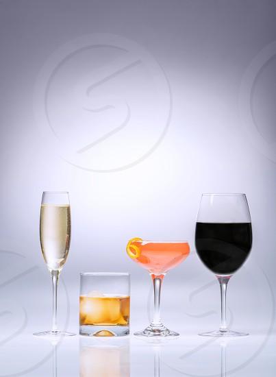 Multiple alcoholic beverages on neutral background photo