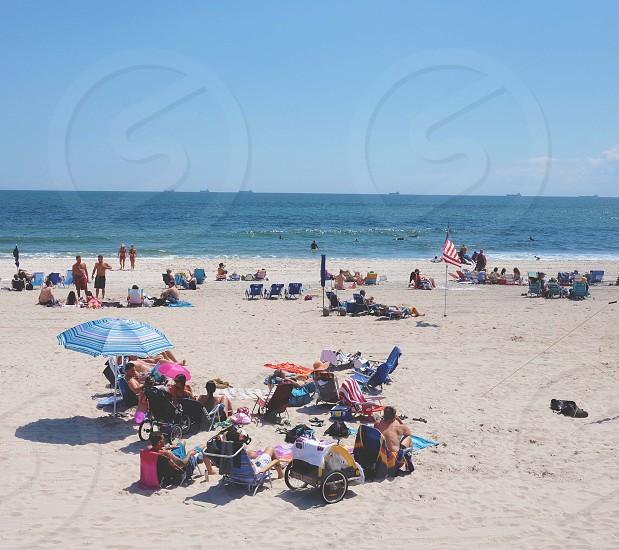people sitting on sand photo