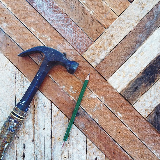 pencil and hammer on wooden floor photo