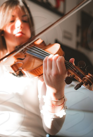 Portrait of girl playing violin at home photo