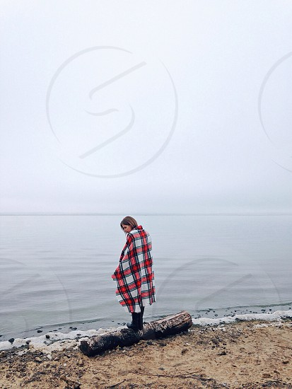 red plaid blanket on a person photo