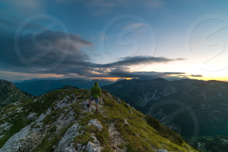 A person at a peak in Julian Alps in the morning. photo
