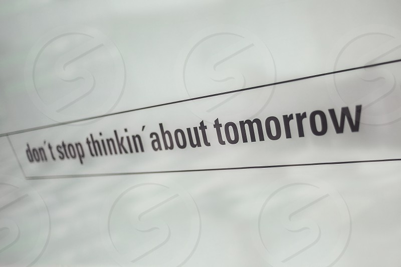 Textual commercial message printed on white glass. photo