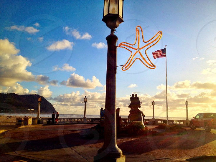 brown and white lamppost with an orange star ornament photo