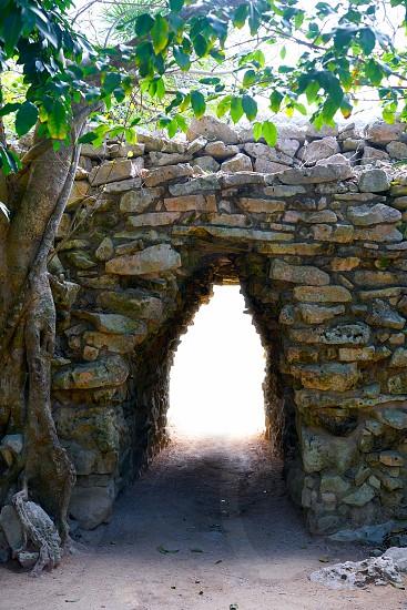 Tulum Mayan arch entrance corridor to ruins in Riviera Maya of Mexico photo