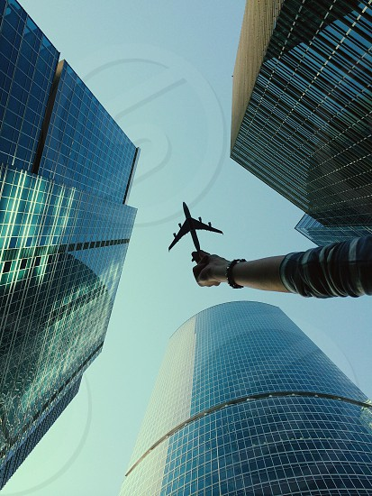 Airline airplane skyscraper looking up building blue creative photo