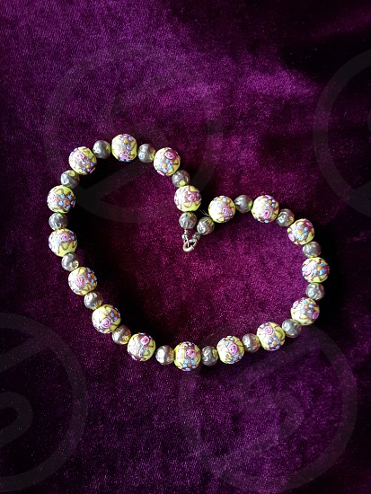Cloisson beaded jewelry formed in shape of heart photo
