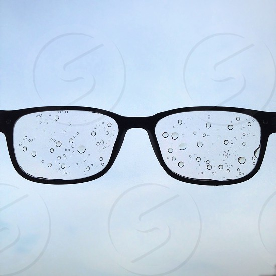 black framed eyeglasses with water droplets photo