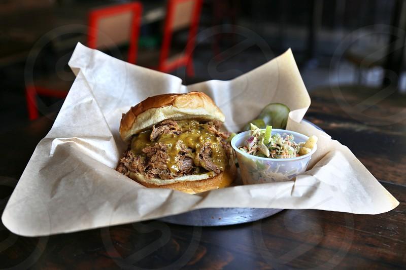 macro photography of burger on white textile during daytime photo