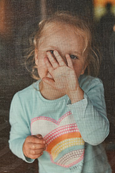 Little adorable girl posing for a portrait. Real people authentic situations photo