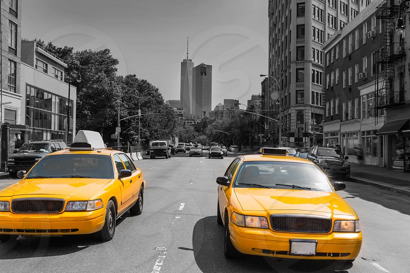New York West Village in Manhattan yellow cab taxi NYC USA photo