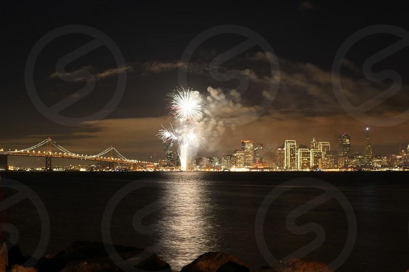 white lighted fireworks displayed near bridge photo