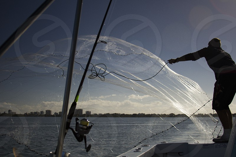person on a white sailing boat photo