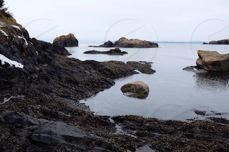 ocean view beside rocky island photo