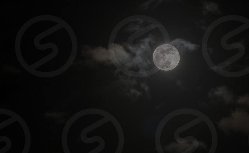 dark black night as background with full moon photo