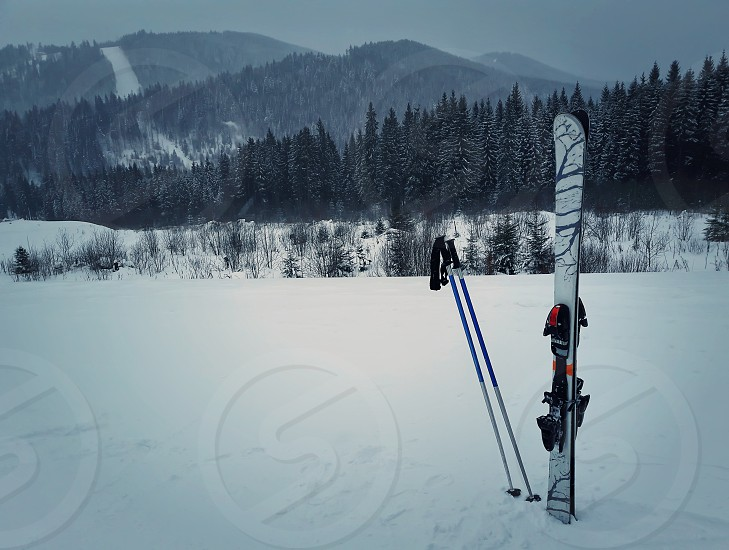 Winter mountains and ski equipment in the snow. Skiing resort winter holidays in Carpathians Bukovel Ukraine. photo