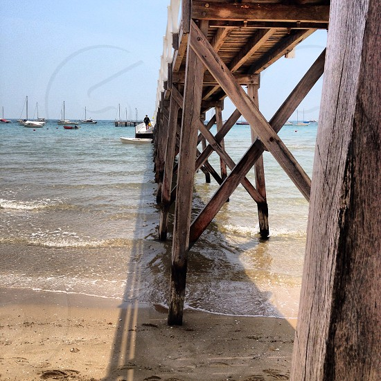 brown wooden sea dock photo