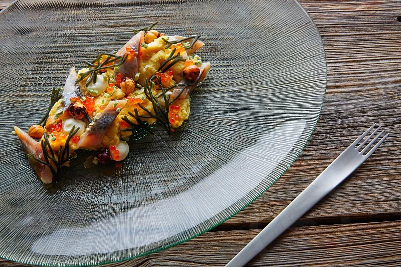Smoked sardines salad with creamy cheese corn codium and hazelnuts photo