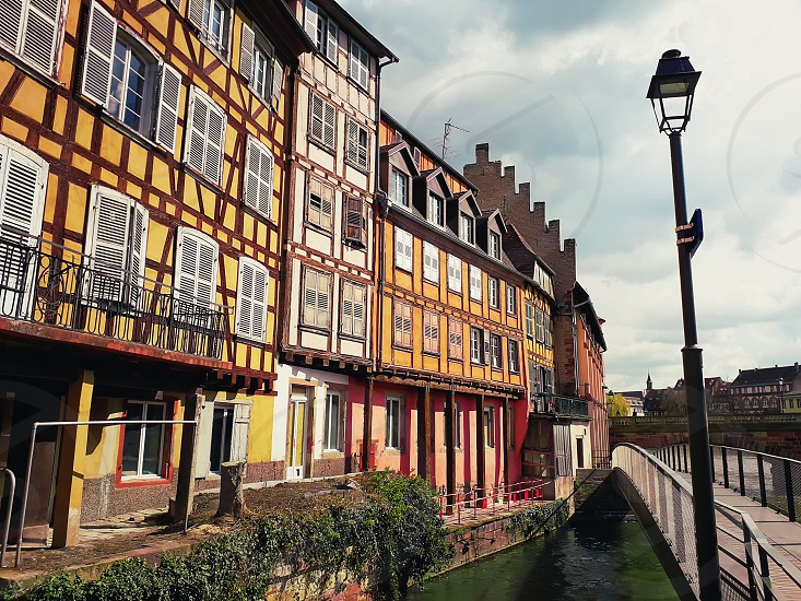Colorful romantic city Strasbourg France Alsace. Traditional houses near the river. Medieval home facade historic town. Beautiful idyllic architecture. photo