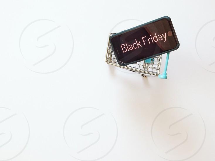 Black friday shopping cart sale sales white background shopping mini deal  photo