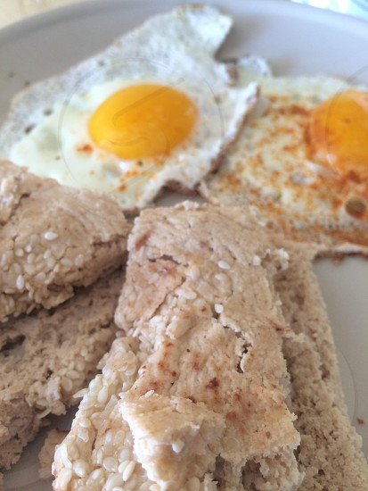 plate with two sunny side-up eggs and rice cakes photo