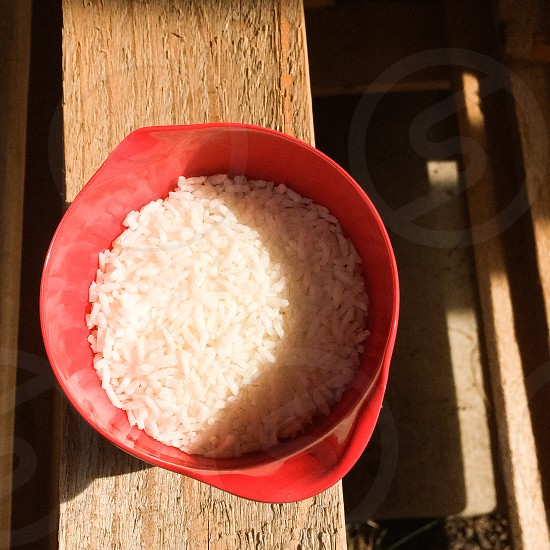 rice on red plastic container photo