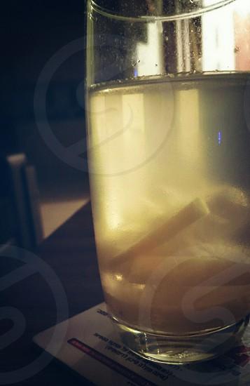 glass shadow shot evening cast inside apartment usual day lemon lemons fruit fresh water juice flesh juicy cold drink close up photo