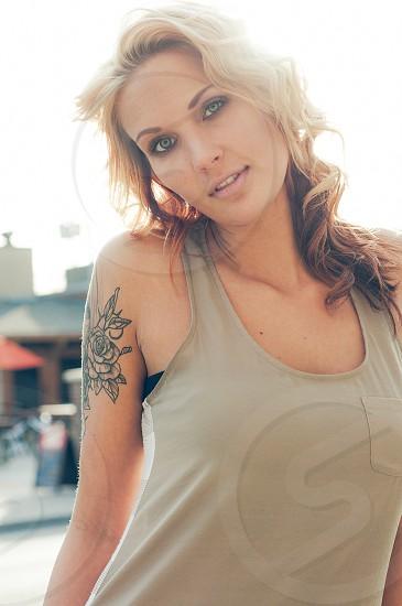 A beautiful tattooed blonde woman in the streets of Manhattan Kansas. photo