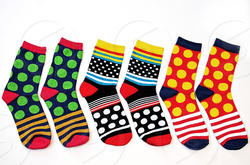 Three pairs of colorful socks on a white background photo