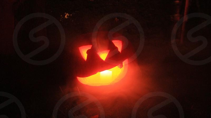 Jack-o-lantern at night with fog photo