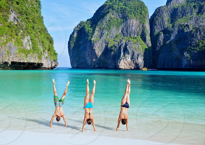 Handstands on 'The Beach.' Koh Phi Phi Leh Thailand. photo