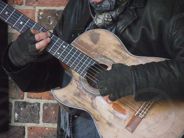 The well loved guitar of a street musician photo