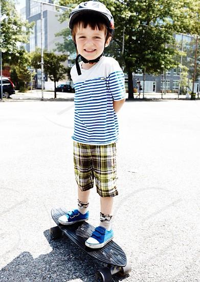 boy on black long board  photo