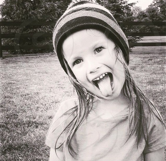 Attitude sassy girl silly personality character tomboy confidence irreverent  photo