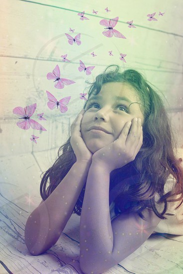 a happy girl dreaming awake with butterflies photo