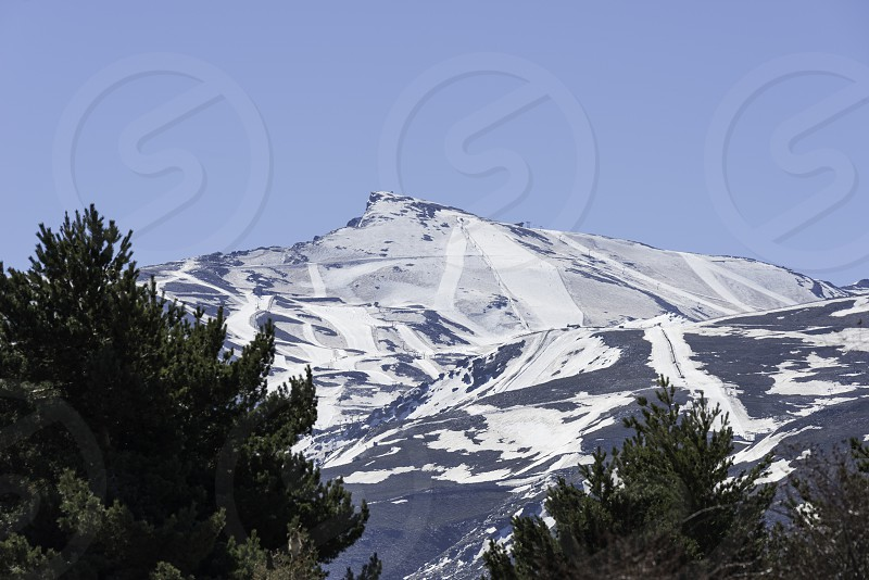 snow on the sierra nevada in spain in may photo