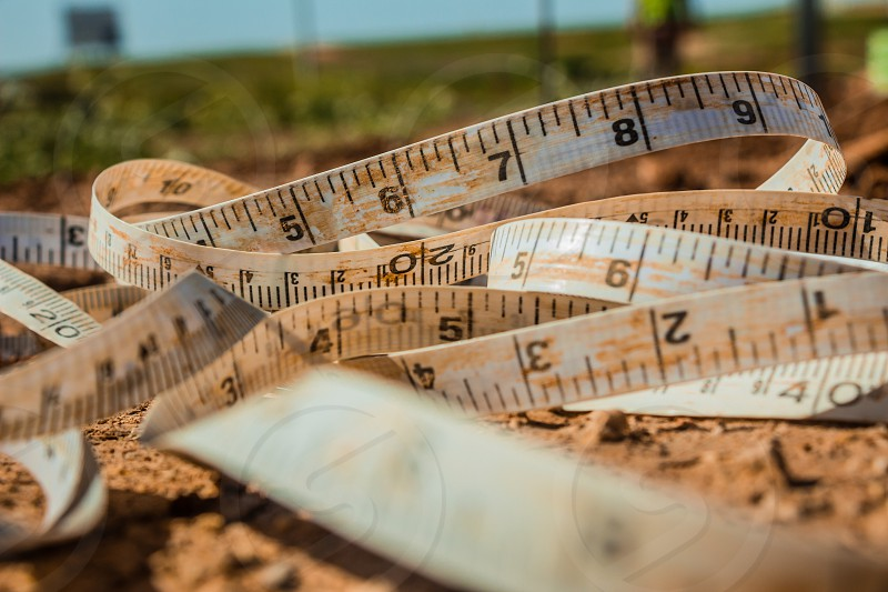 Measuring tape placed on the ground at a construction site. photo