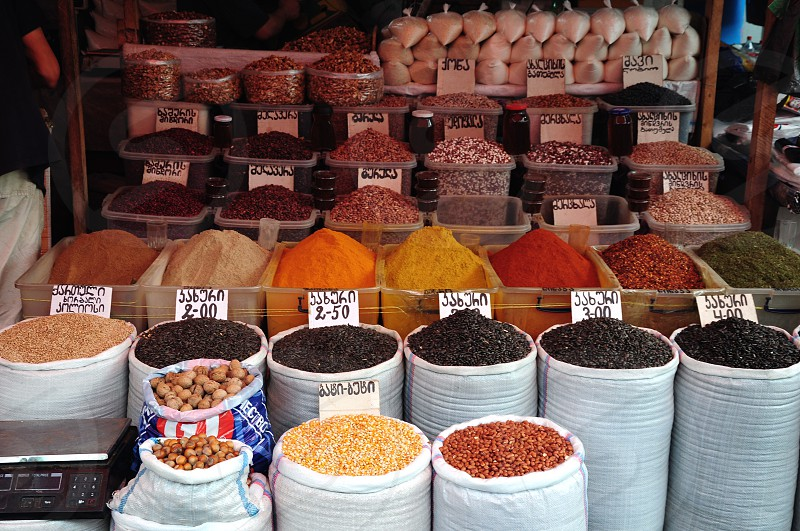 various spices in white burplap bags photo