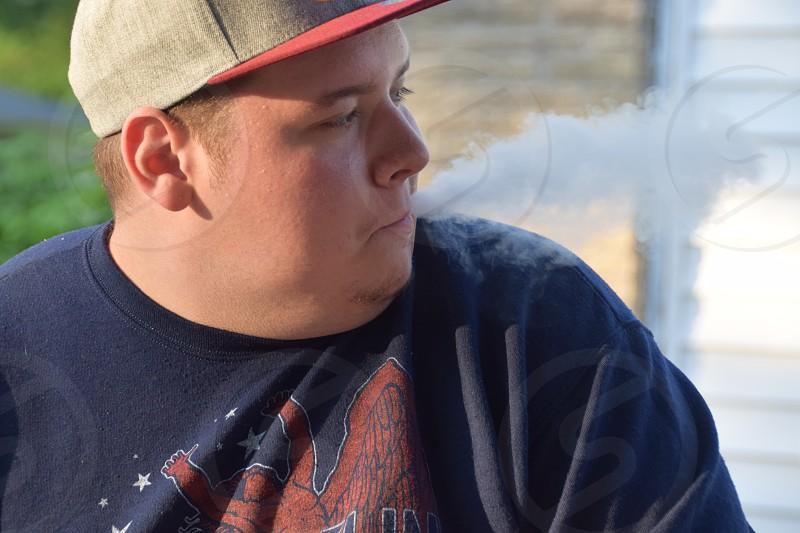 Young Man Vaping photo