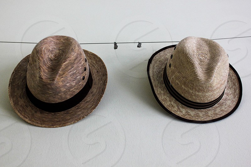 two brown and white bucket hat photo