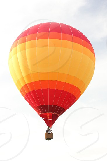 yellow and red striped hot air balloon photo