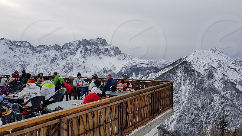 Terrace in the mountains.  People sitting in a bar outdoors. photo