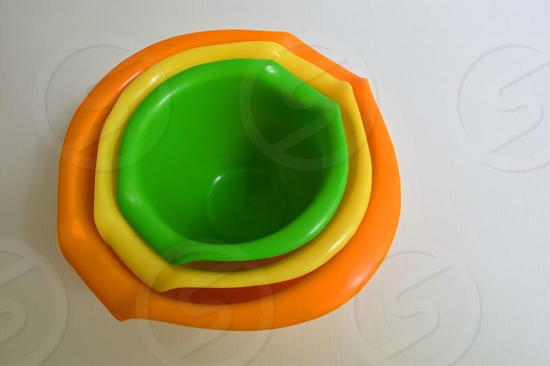 Colorful plastic bowls photo